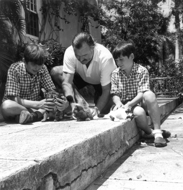 EH 2871P November 1946 Ernest Hemingway and sons Patrick (left) and Gregory, with cats Good Will, Princessa, and Boise. Finca Vigia (Hemingway home), San Francisco de Paula, Cuba. Photograph in the Ernest Hemingway Photograph Collection, John F. Kennedy Presidential Library and Museum, Boston.